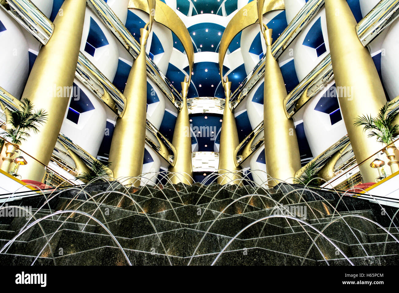 Atrium with fountains in the Burj Al Arab hotel, Dubai - Stock Image