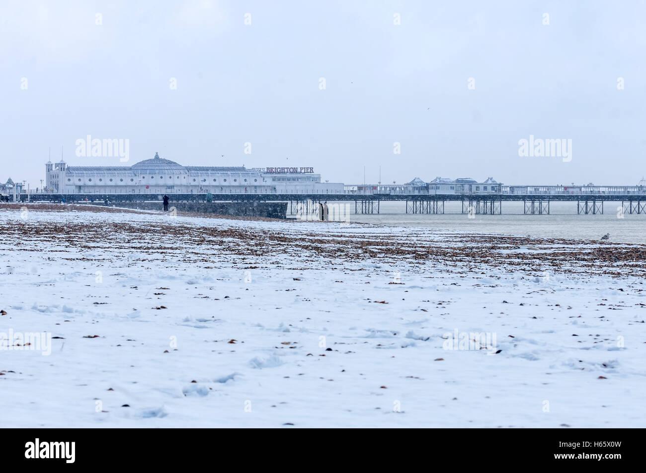 Snowfall on Brighton beach - Stock Image