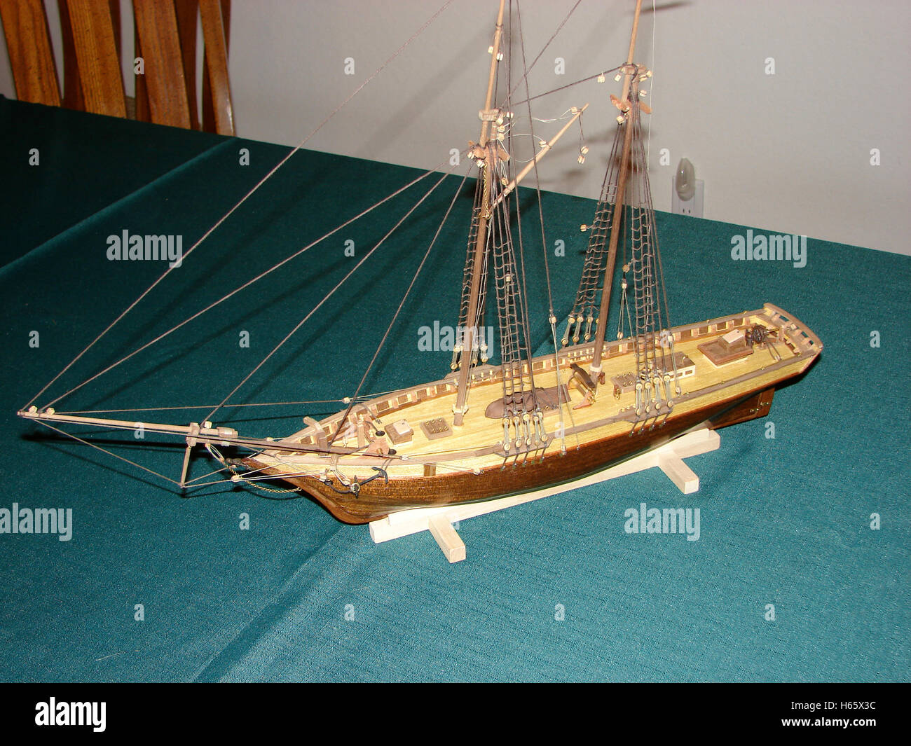 Wooden model ship fully rigged but without sails - Stock Image