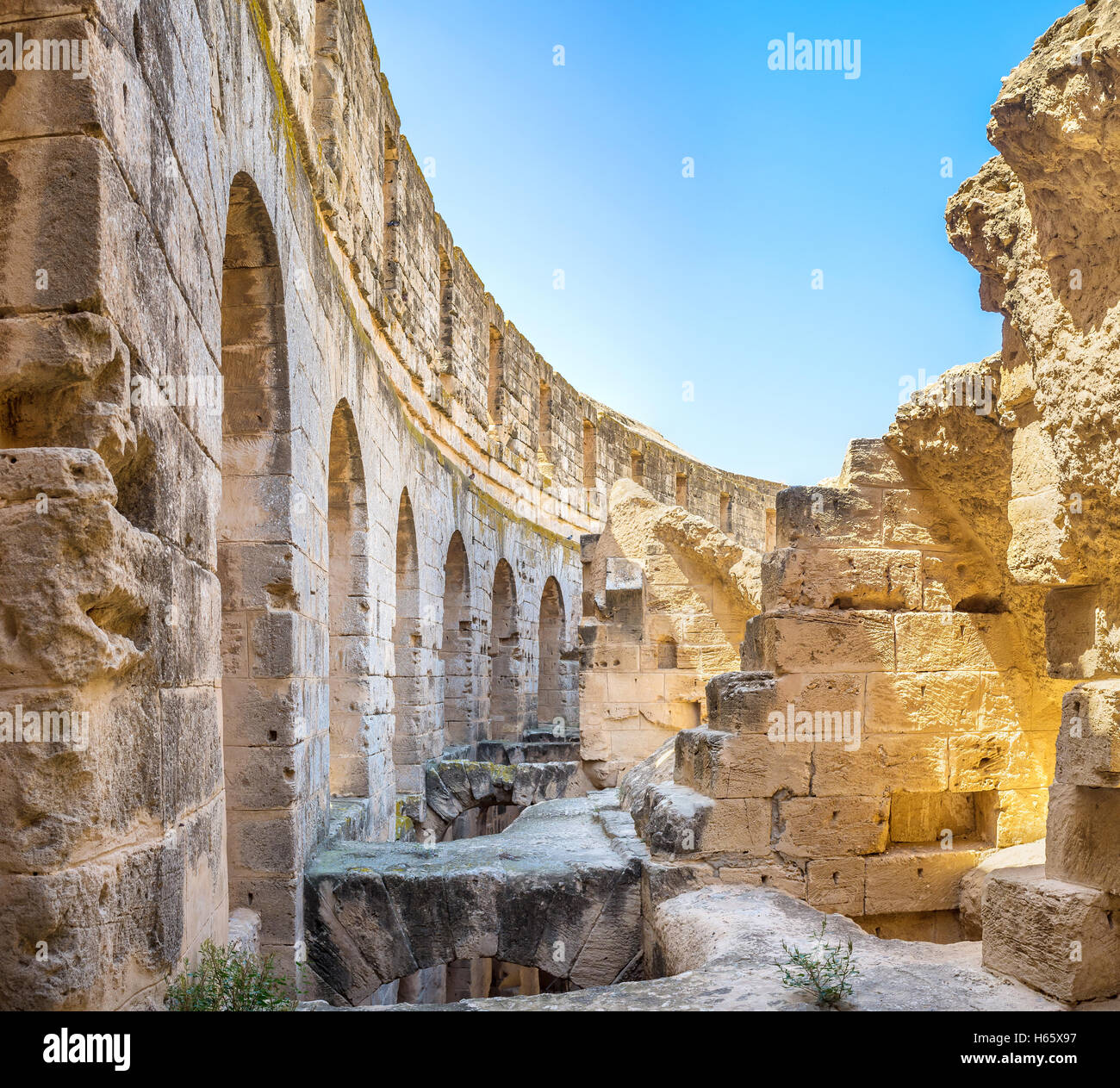 Some of constructions in the old Roman amphitheatre were ruined, but the main wall is in good condition, El Jem - Stock Image