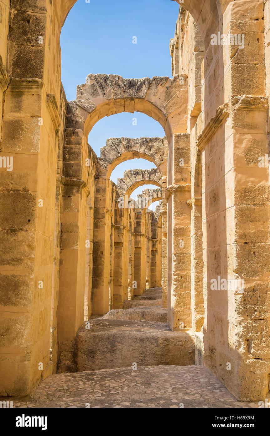 Nowadays tourists enjoy the ancient Roman amphitheatre, that serves as the archaeological museum, El Jem Tunisia - Stock Image