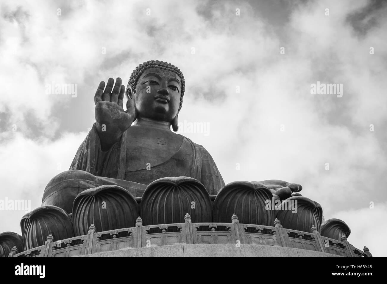 Tian Tan Buddha (Big Buddha) statue in black&white at Ngong Ping on Lantau Island in Hong Kong, China, viewed - Stock Image