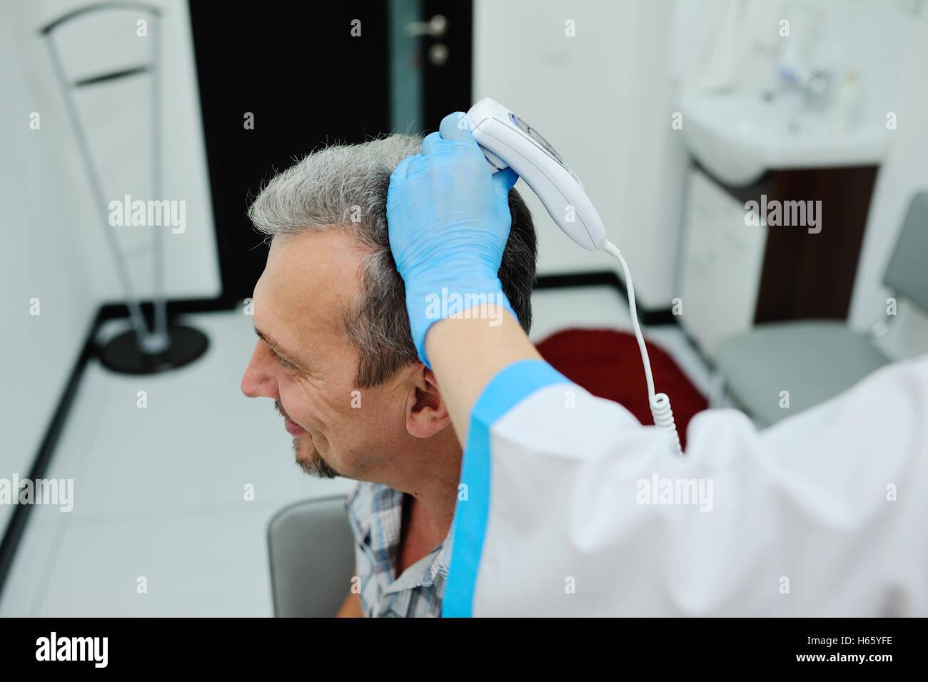 diagnostics hair and scalp. Trihoskopiya. - Stock Image