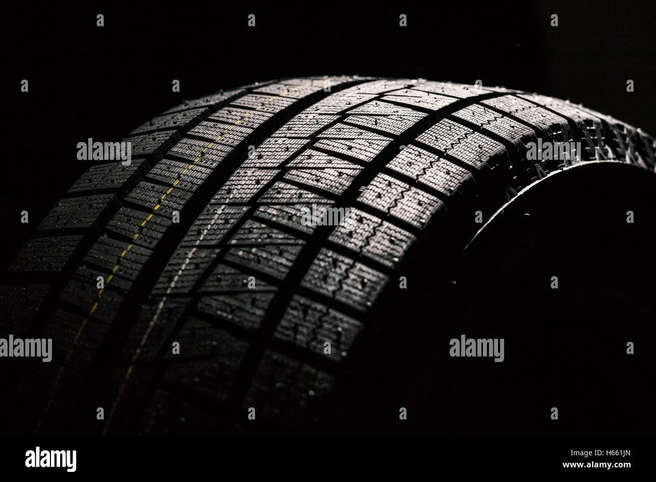 High Performance Winter Tire On Black Background - Stock Image