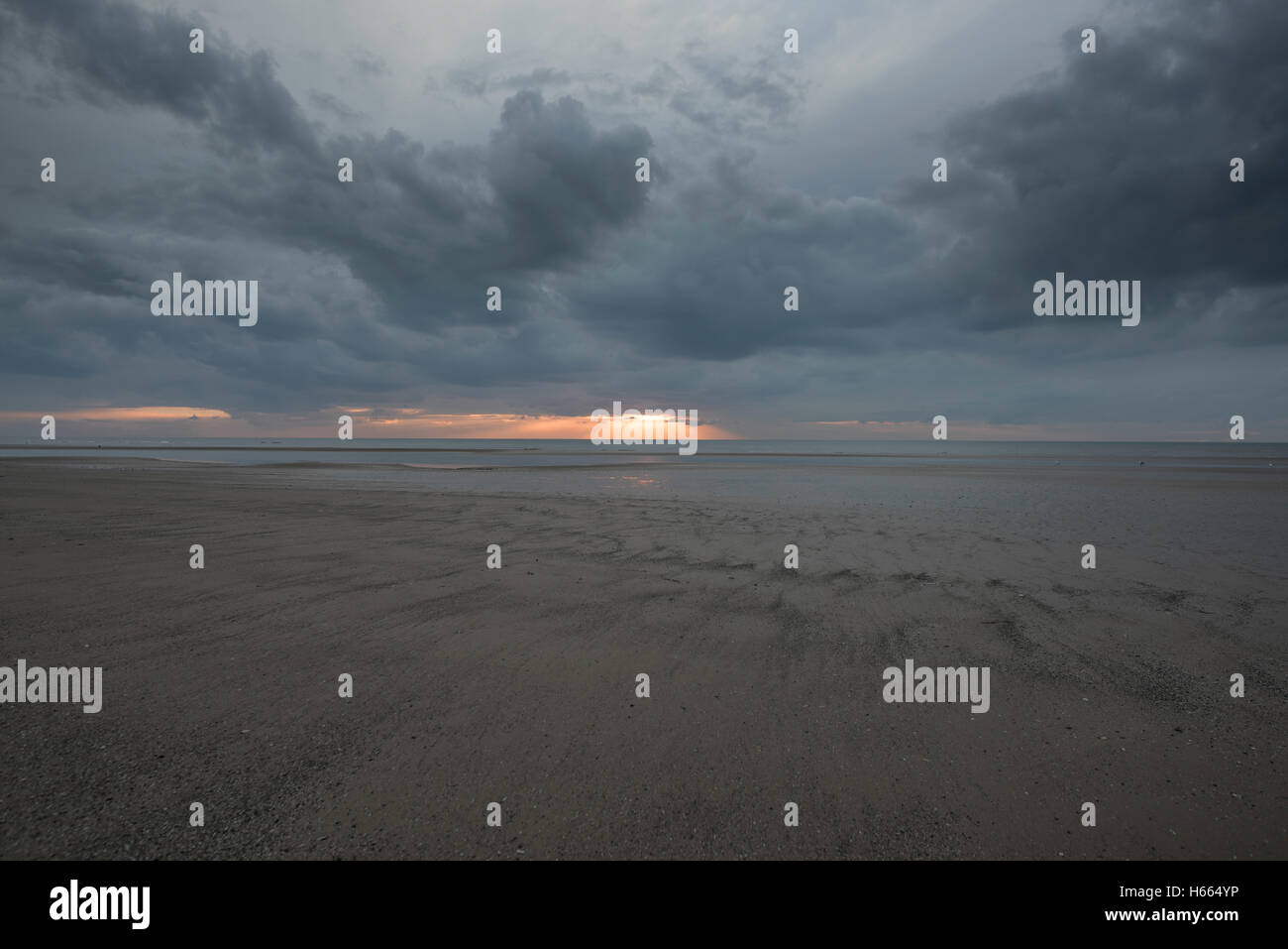 Dark, moody sunset in Blackpool, England during autumn while the famous Black Illuminations are lit up Stock Photo