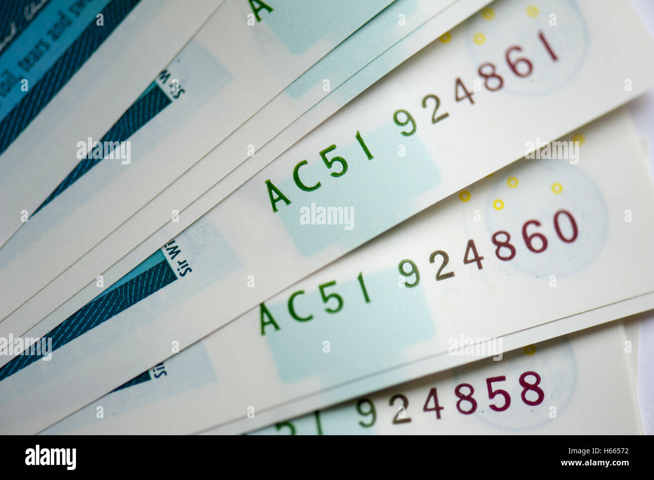 Close up of serial numbers on the UK's new five pound note - Stock Image