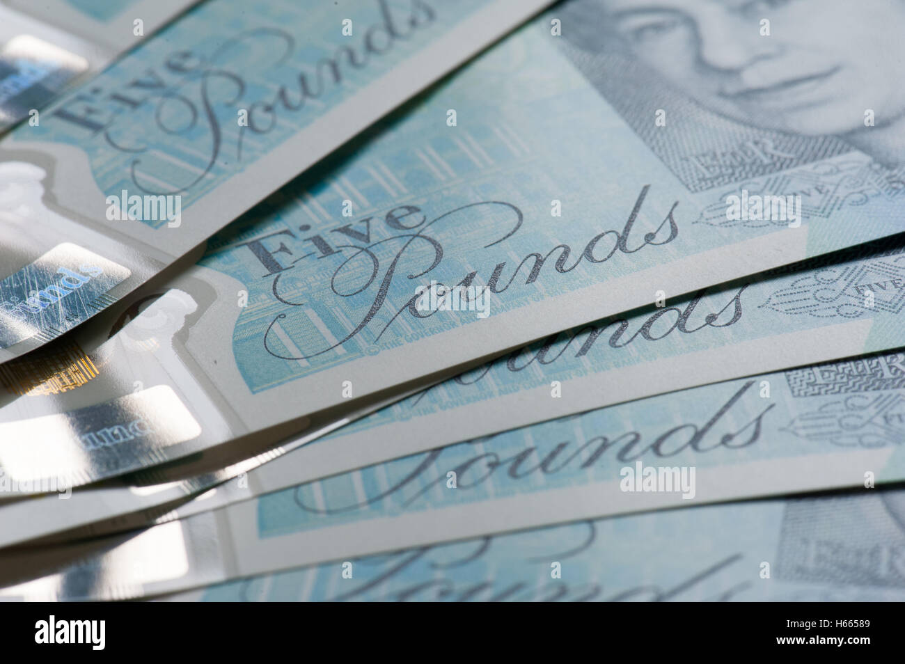 New five pound notes, close up, - Stock Image