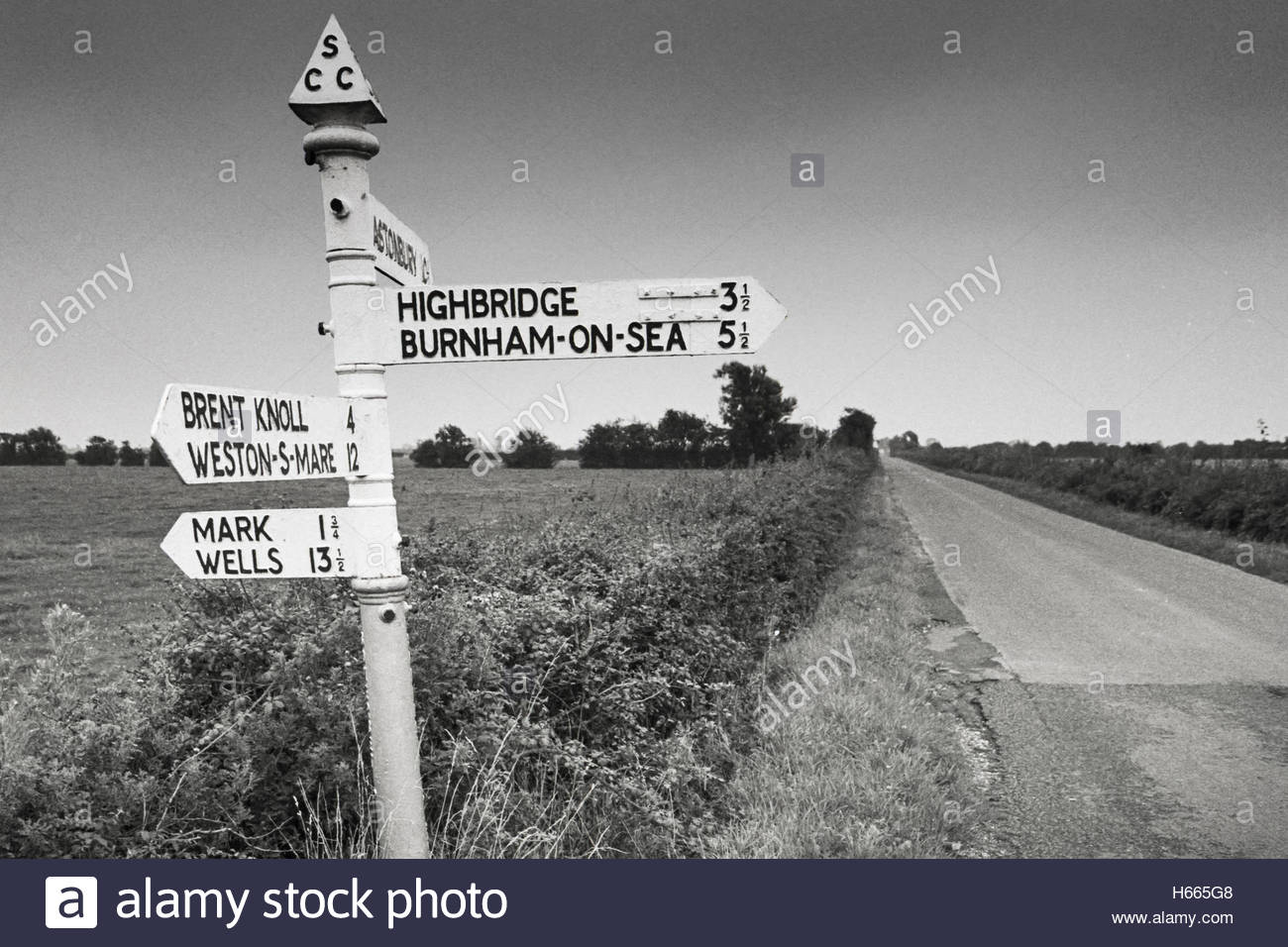 Somerset Levels in the 1990s; cast iron fingerpost road sign with finial at Mark Moor, Somerset Levels, UK - 1994 - Stock Image