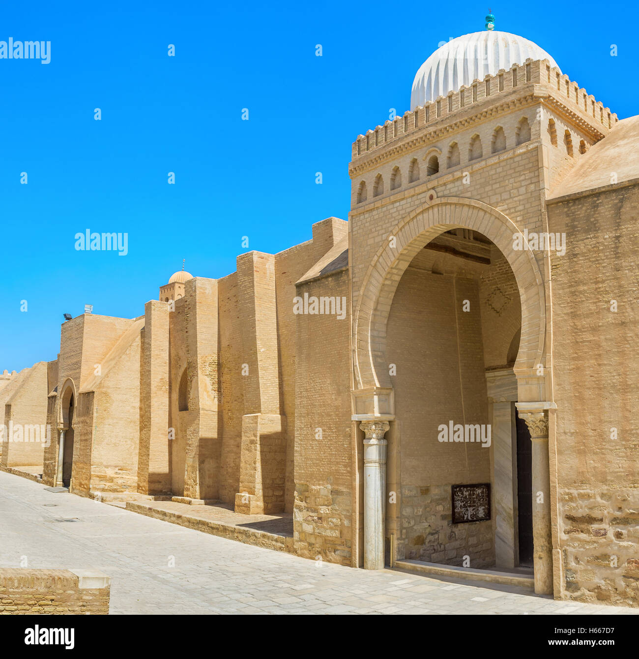 The outer wall of the Grand Mosque is the huge medieval rampart with gates in arabic style with beautiful domes, - Stock Image