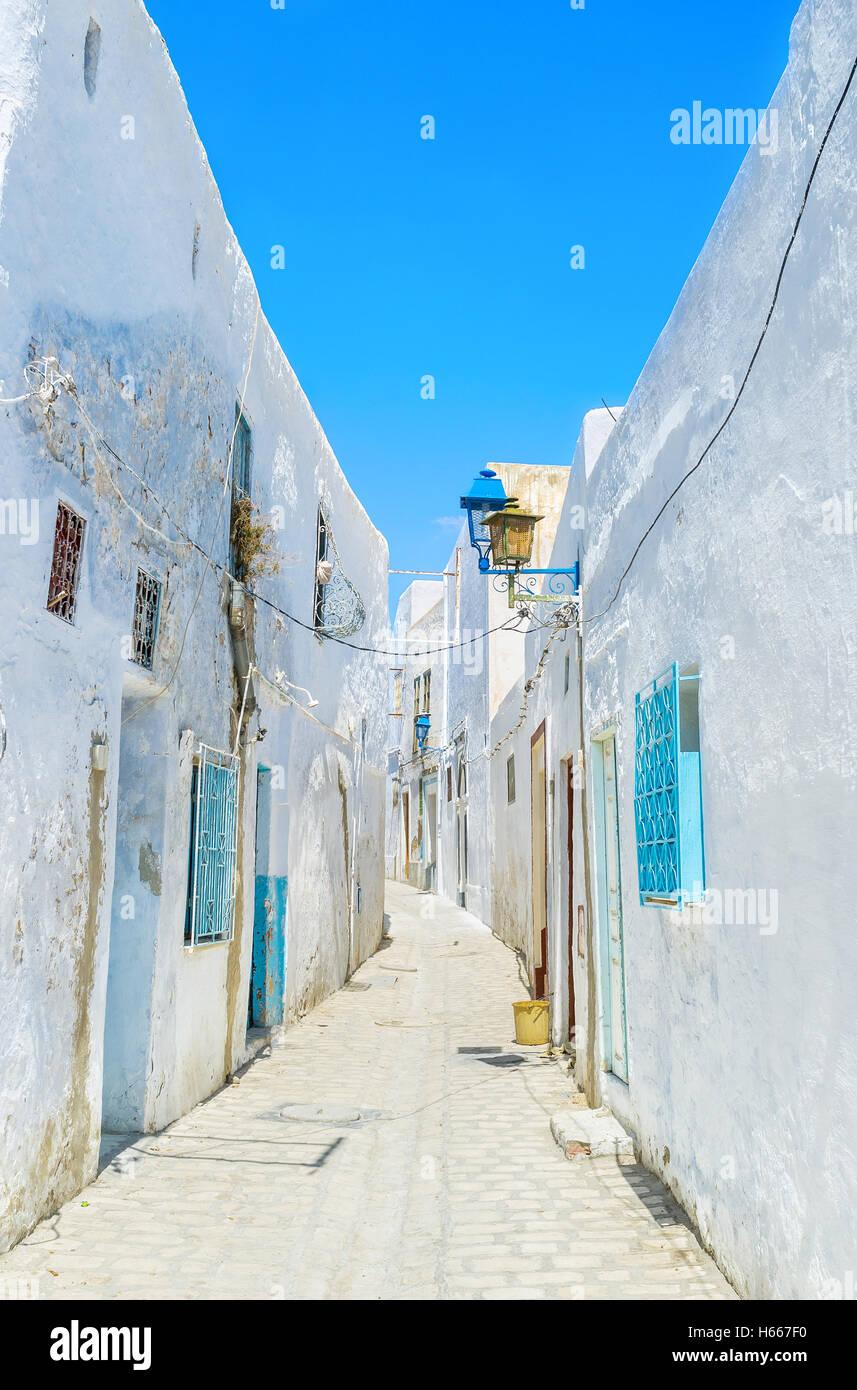 Medina of Kairouan is the maze of many narrow streets with tiny white houses, Tunisia. - Stock Image