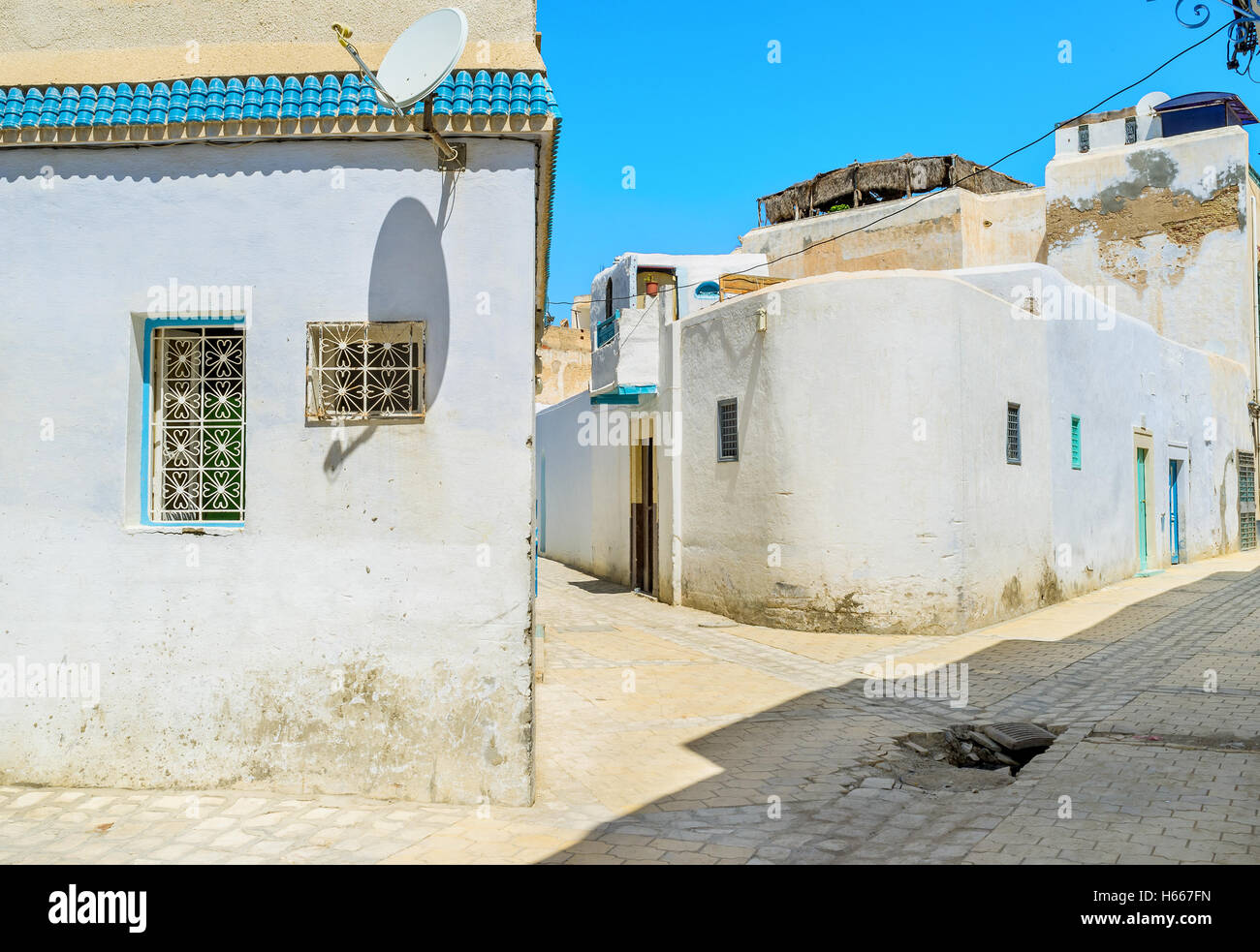 The lazy walk in the maze of streets in arabic Medina is the interesting timespending and unique experience, Kairouan, - Stock Image