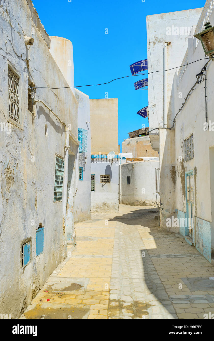 The old houses of Medina look the same outside, all their beauty is inside, Kairouan, Tunisia. - Stock Image