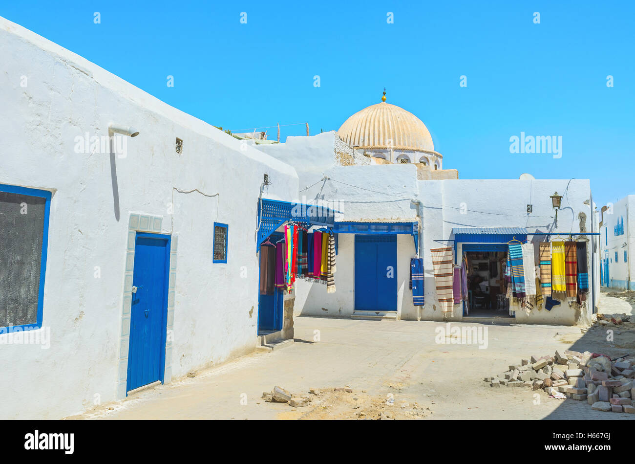 The historic neighborhood with numerous weaving workshops and draperies, Kairouan, Tunisia. - Stock Image
