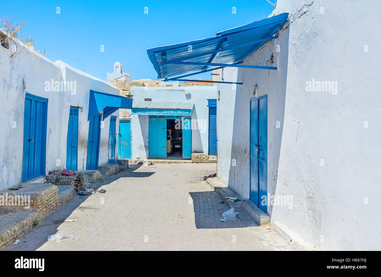 The working neighborhood with many weaving workshops and draperies in Medina of Kairouan, Tunisia. - Stock Image