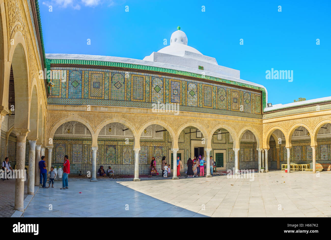 The richly decorated courtyard leads to the prayer hall of the Barber's Mosque, Kairouan Tunisia - Stock Image