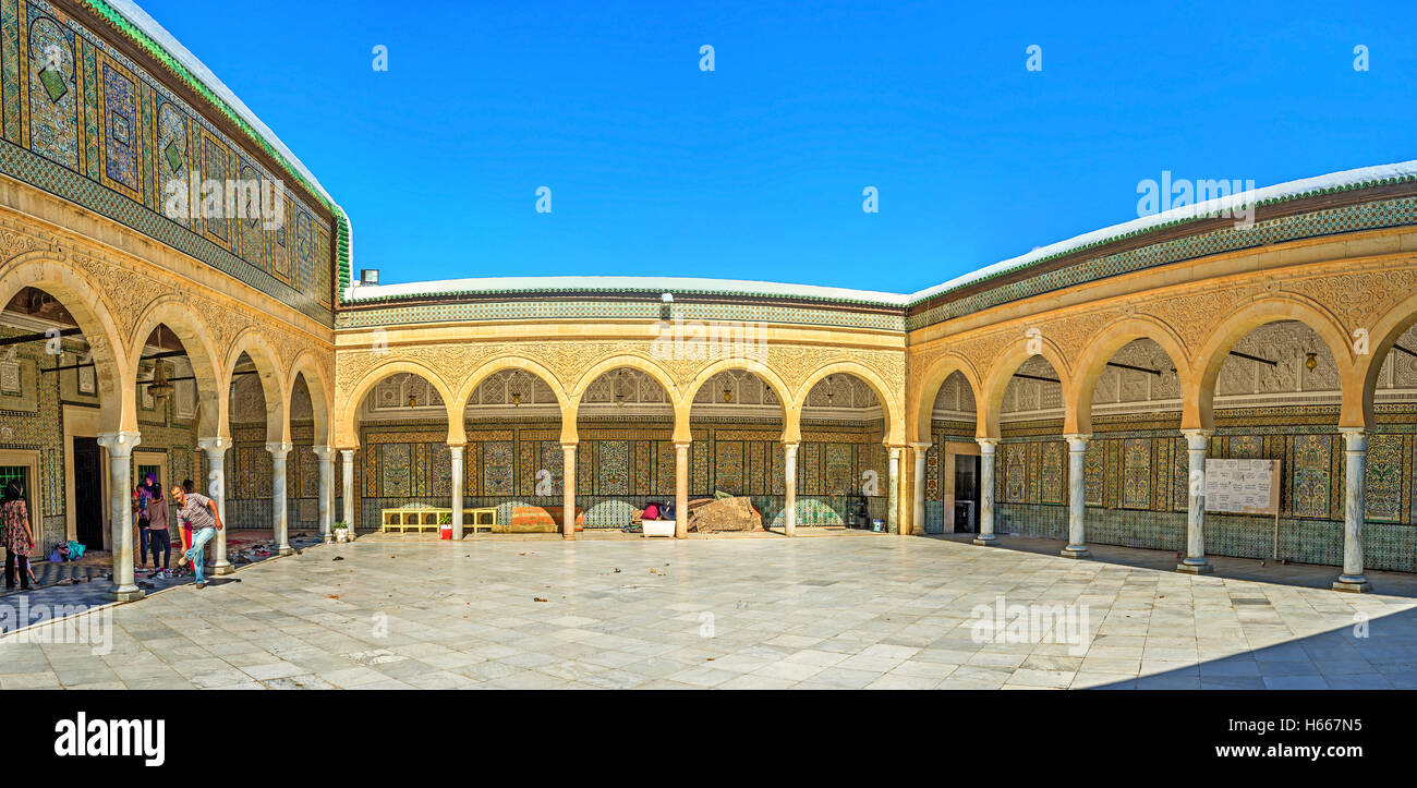 The courtyard in front of the prayer hall of Barber's mosque, decorated with colorful patterns on tiles, Kairouan - Stock Image