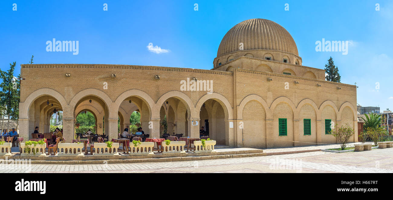 The building of the old mausoleum rebuild into the cafe with large shady terrace, Kairouan Tunisia - Stock Image