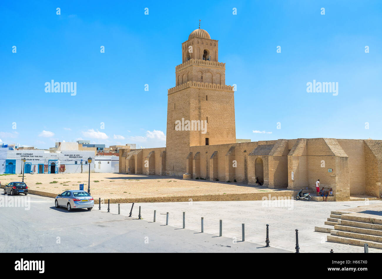 The medieval Grand Mosque looks like the defensive fortress with a high ramparts, huge minaret and large courtyard - Stock Image