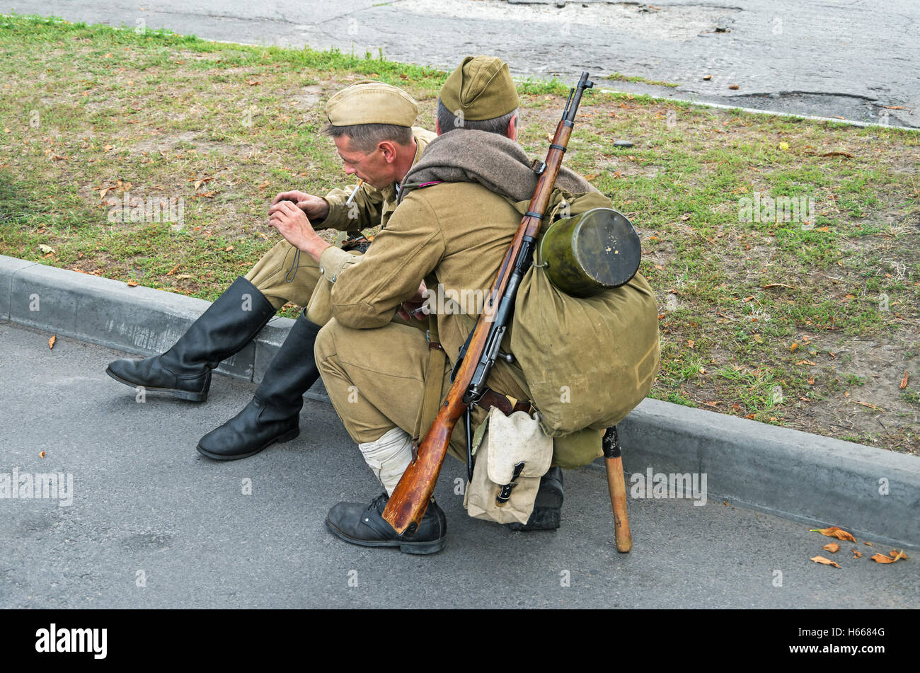 Dnepropetrovsk, Ukraine - September 14, 2013: Group of unidentified re-enactors dressed as Soviet soldiers in greatcoat Stock Photo