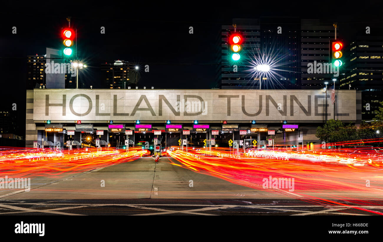 Holland Tunnel toll booth by night. The Holland Tunnel is a highway tunnel under the Hudson River between New York - Stock Image