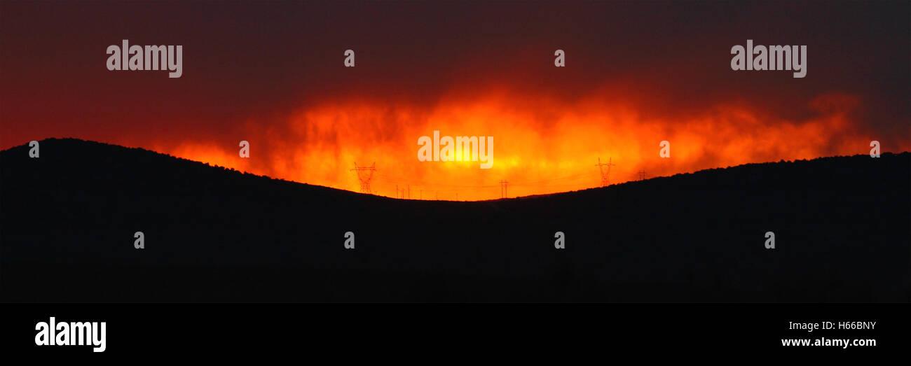 Sunset burning in armageddon. - Stock Image