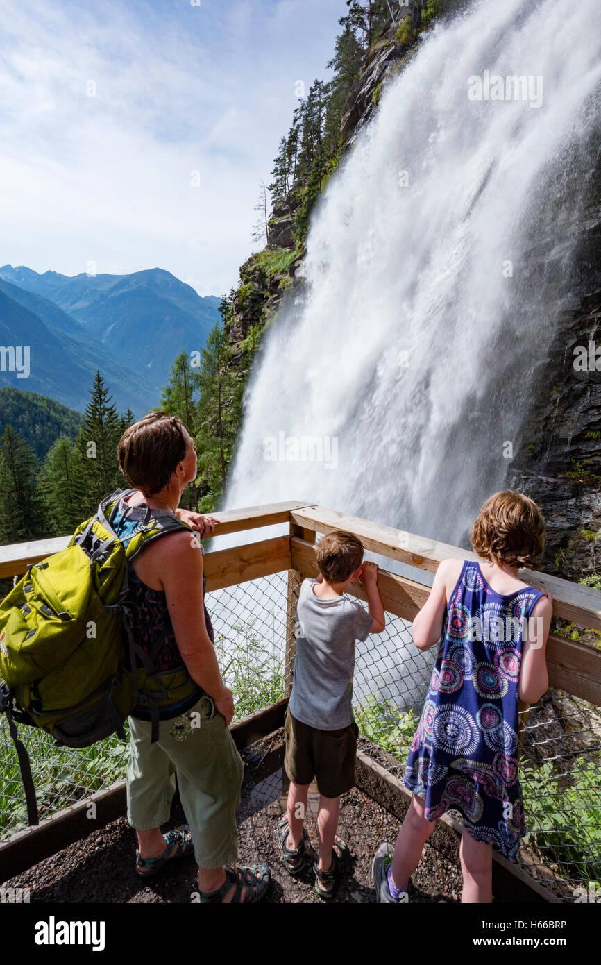 Tourists beneath Stuibenfall waterfall, Otztal, Valley, Tyrol, Austria. - Stock Image