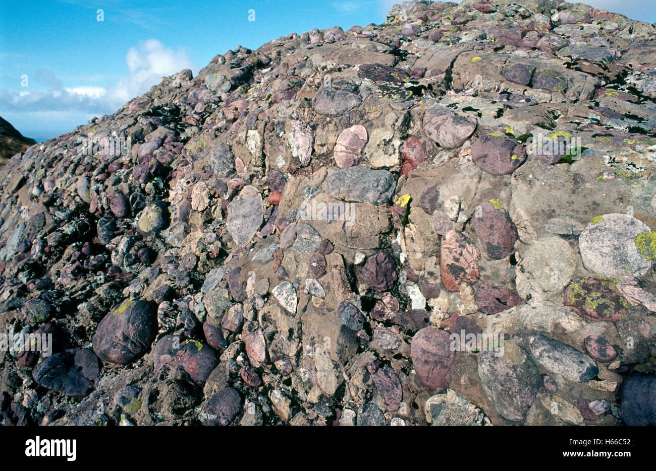 Sandstone conglomerate rock above Killary Harbour, County Glalway, Ireland. - Stock Image