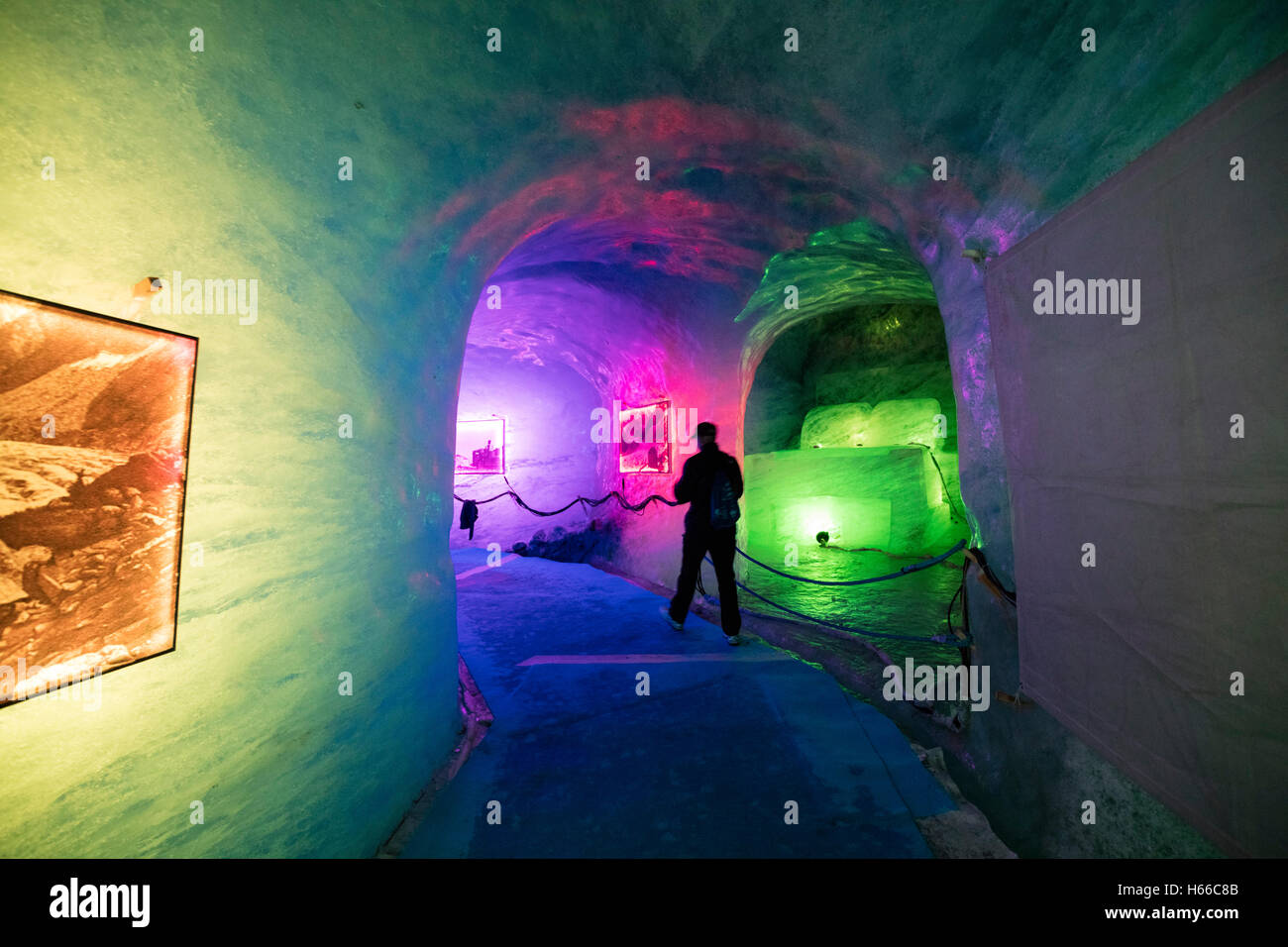 Illuminated ice cave inside Mer de Glace glacier, Montenvers. Chamonix Valley, French Alps, France. - Stock Image