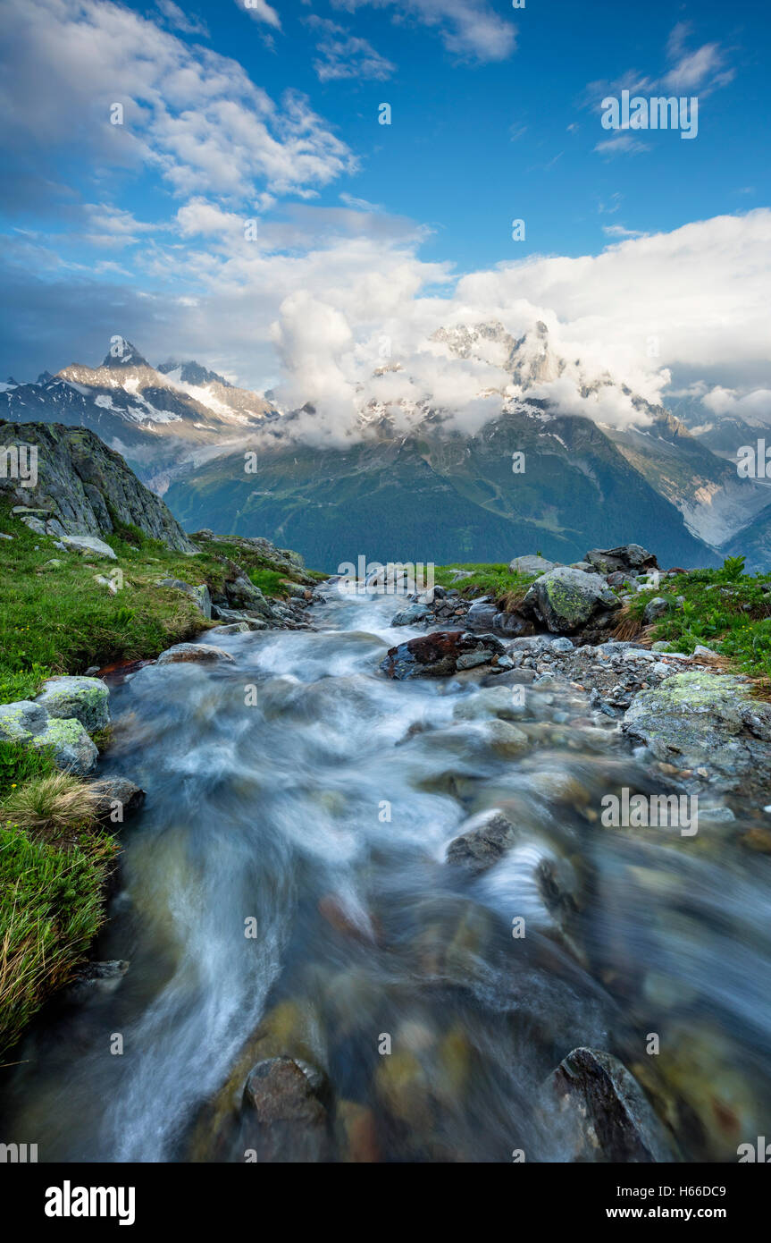 Stream beneath Aiguille Verte, Chamonix Valley, French Alps, France. - Stock Image