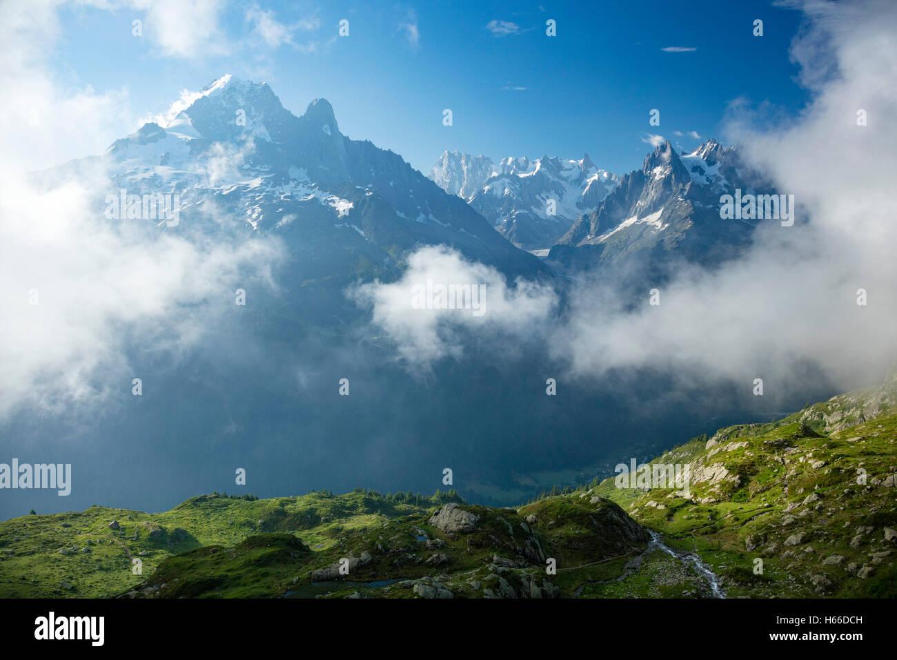Aiguille Verte rises across the Chamonix Valley, Haute Savoie, French Alps, France. - Stock Image