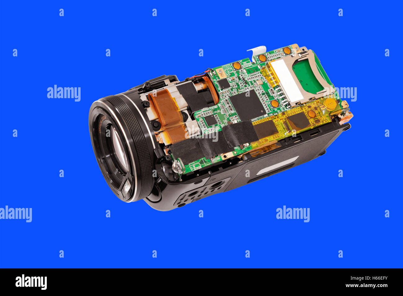 Disassembled compact camcorder. Close-up. Isolated on blue background. - Stock Image