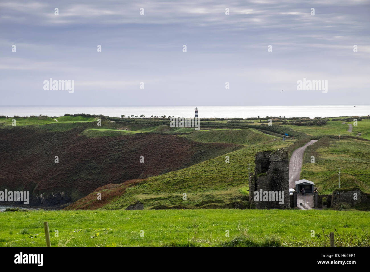 The old Head of Kinsale golf links and lighthouse, County Cork, Ireland. - Stock Image