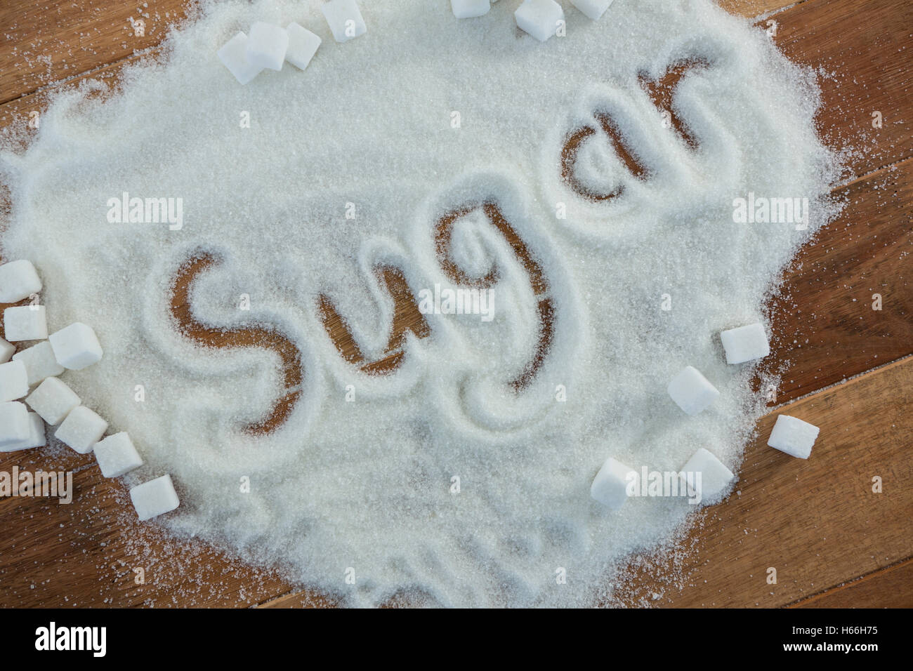 Sugar written on sugar powder - Stock Image