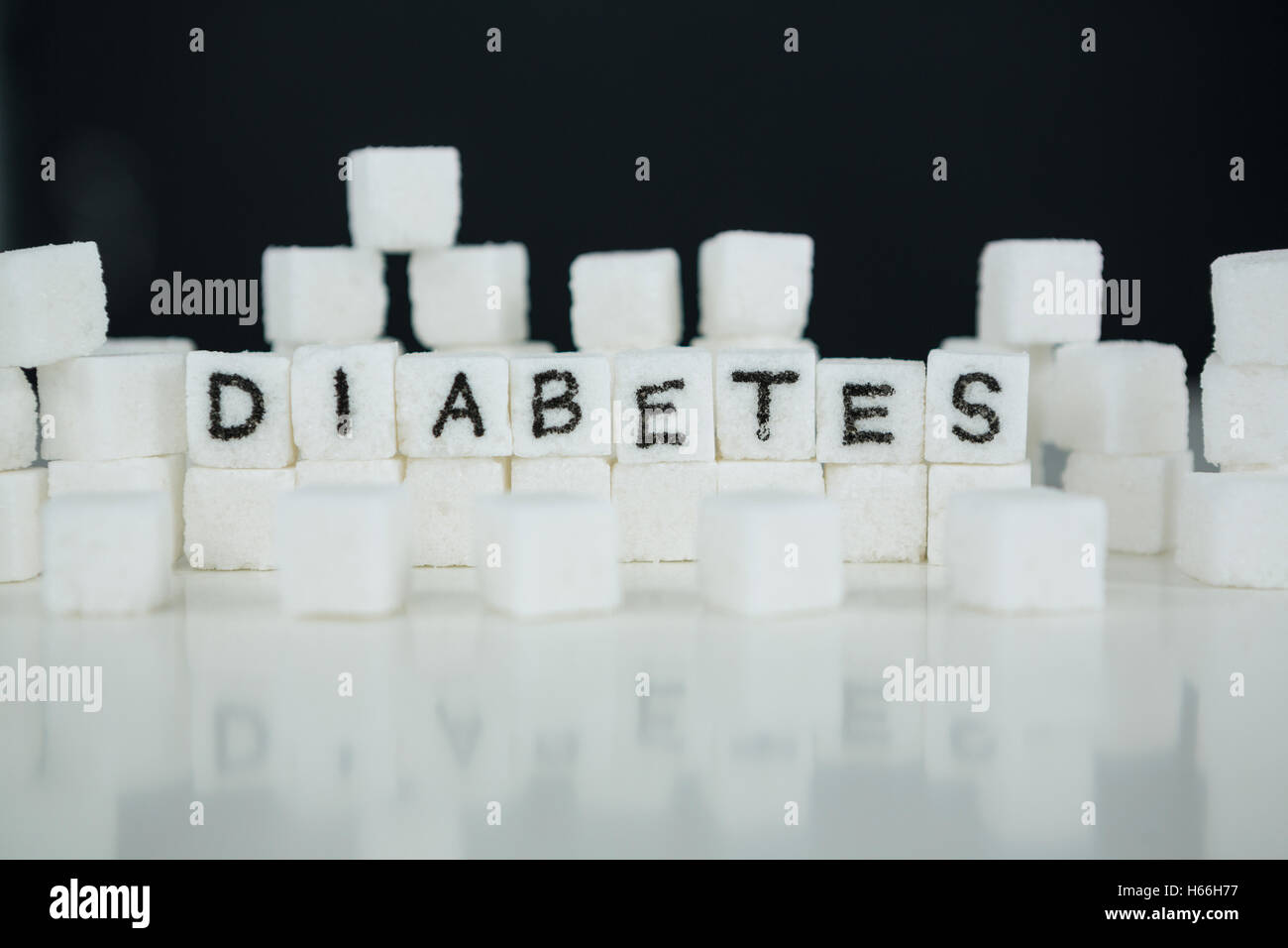 Sugar cubes spelling out diabetes - Stock Image