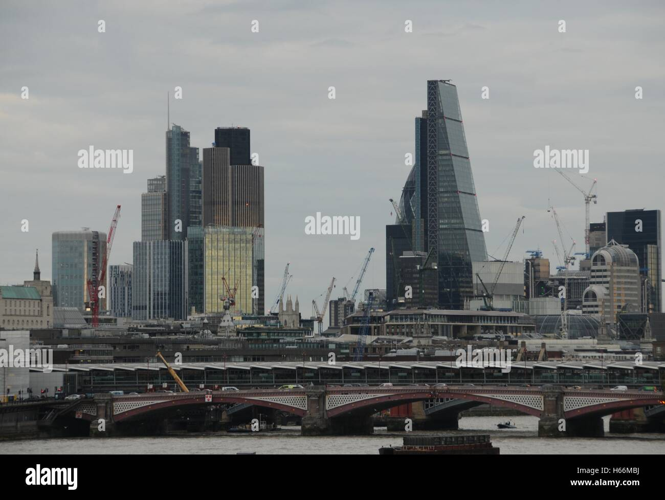 A view of the City's skyscrapers and London's river Thames. - Stock Image