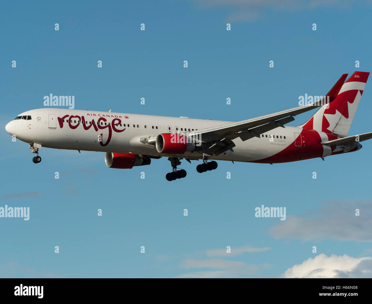 Air Canada rouge Boeing 767 (767-300ER) C-FMXC airliner final approach for landing Vancouver International Airport,Canada Stock Photo
