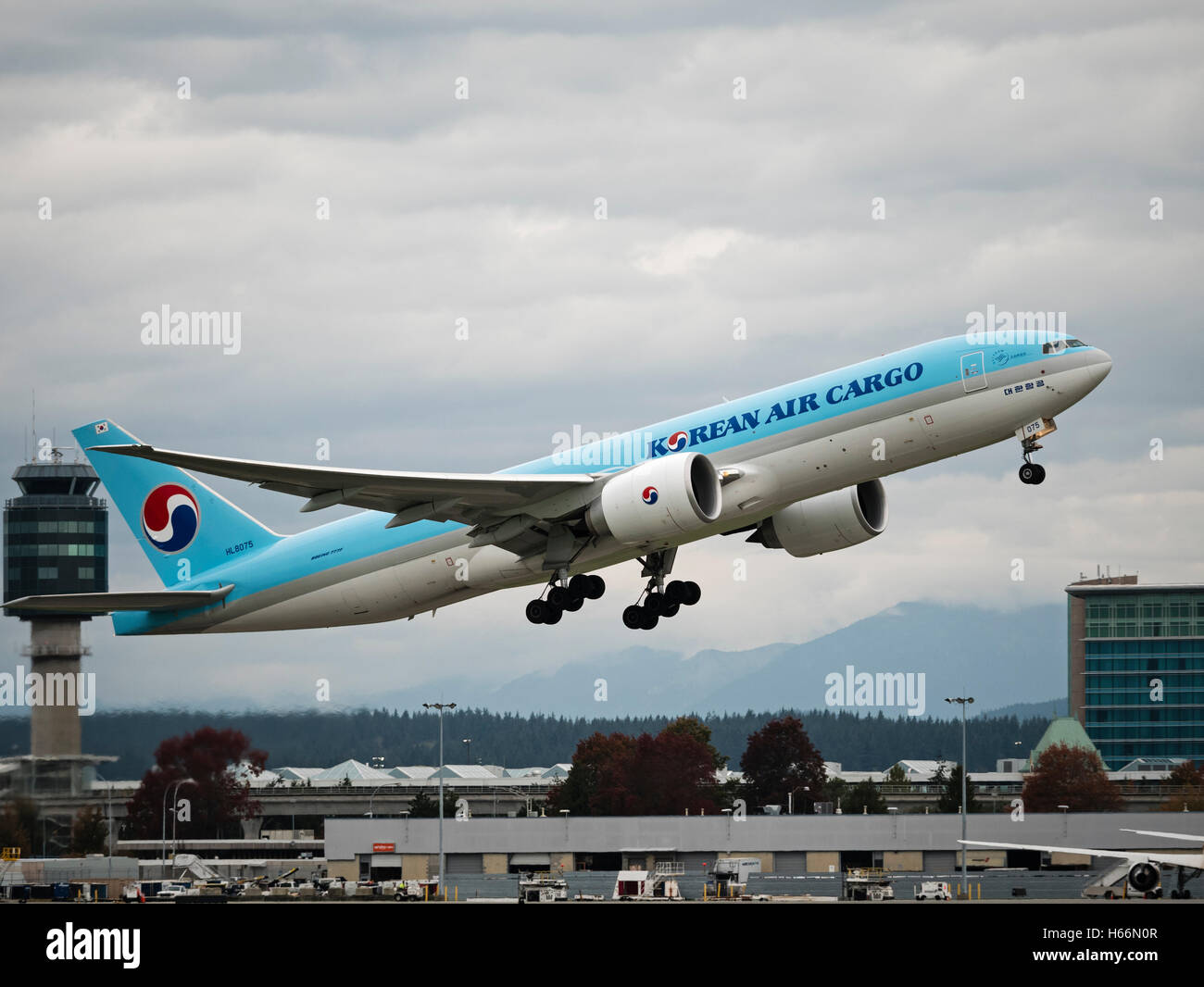 A Korean Air Cargo Boeing 777F HL8075 air cargo freighter taking off from Vancouver International Airport Canada - Stock Image
