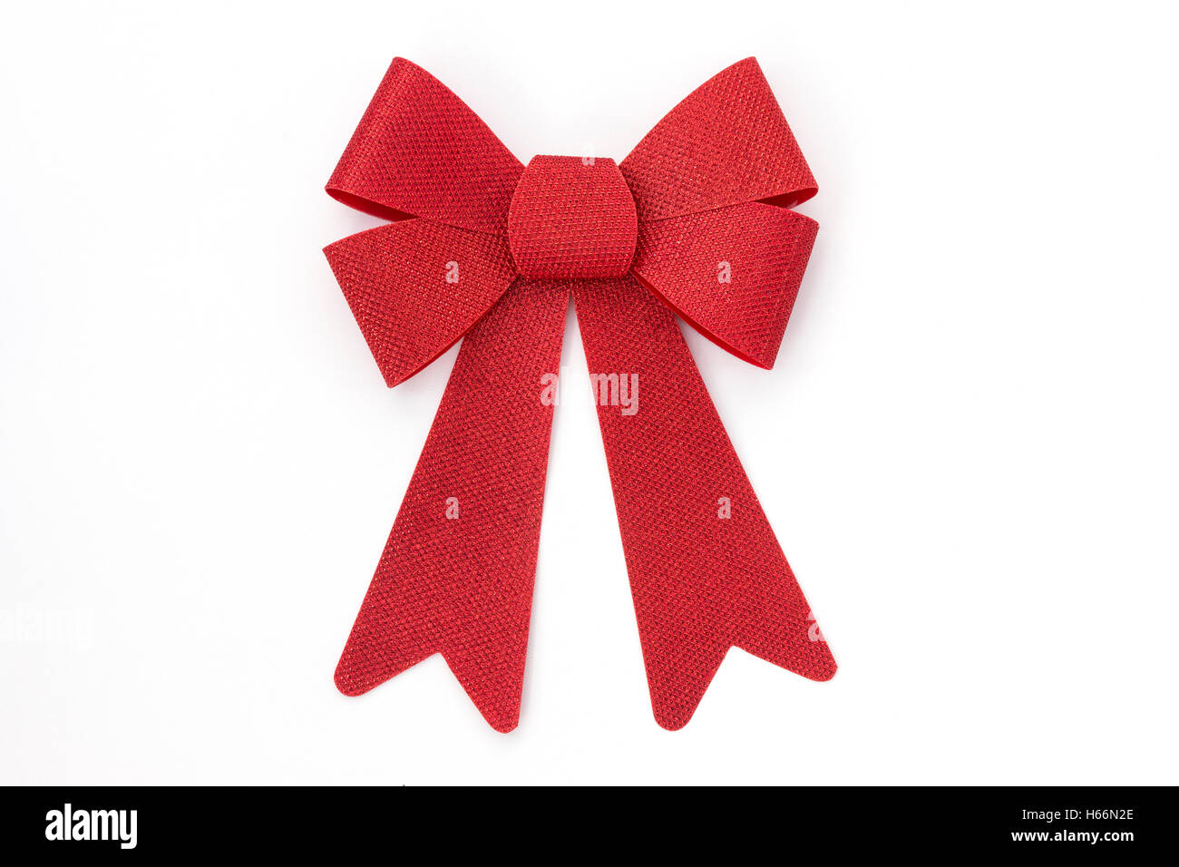 Shiny red Christmas holiday bow isolated on white background, graphic resource - Stock Image
