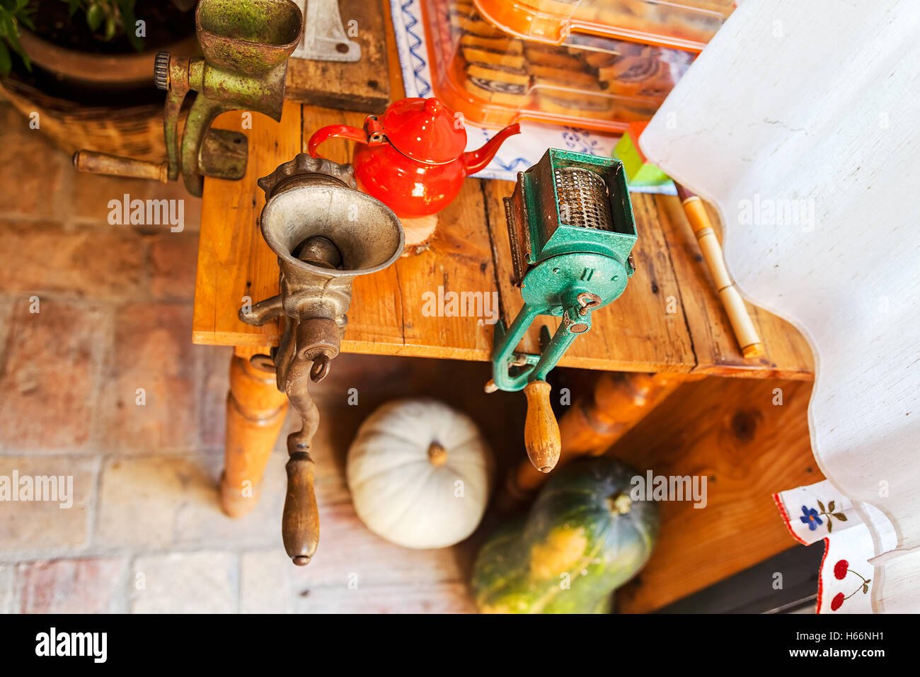 manual mills for grind and preparing food for winter, note shallow depth of field - Stock Image