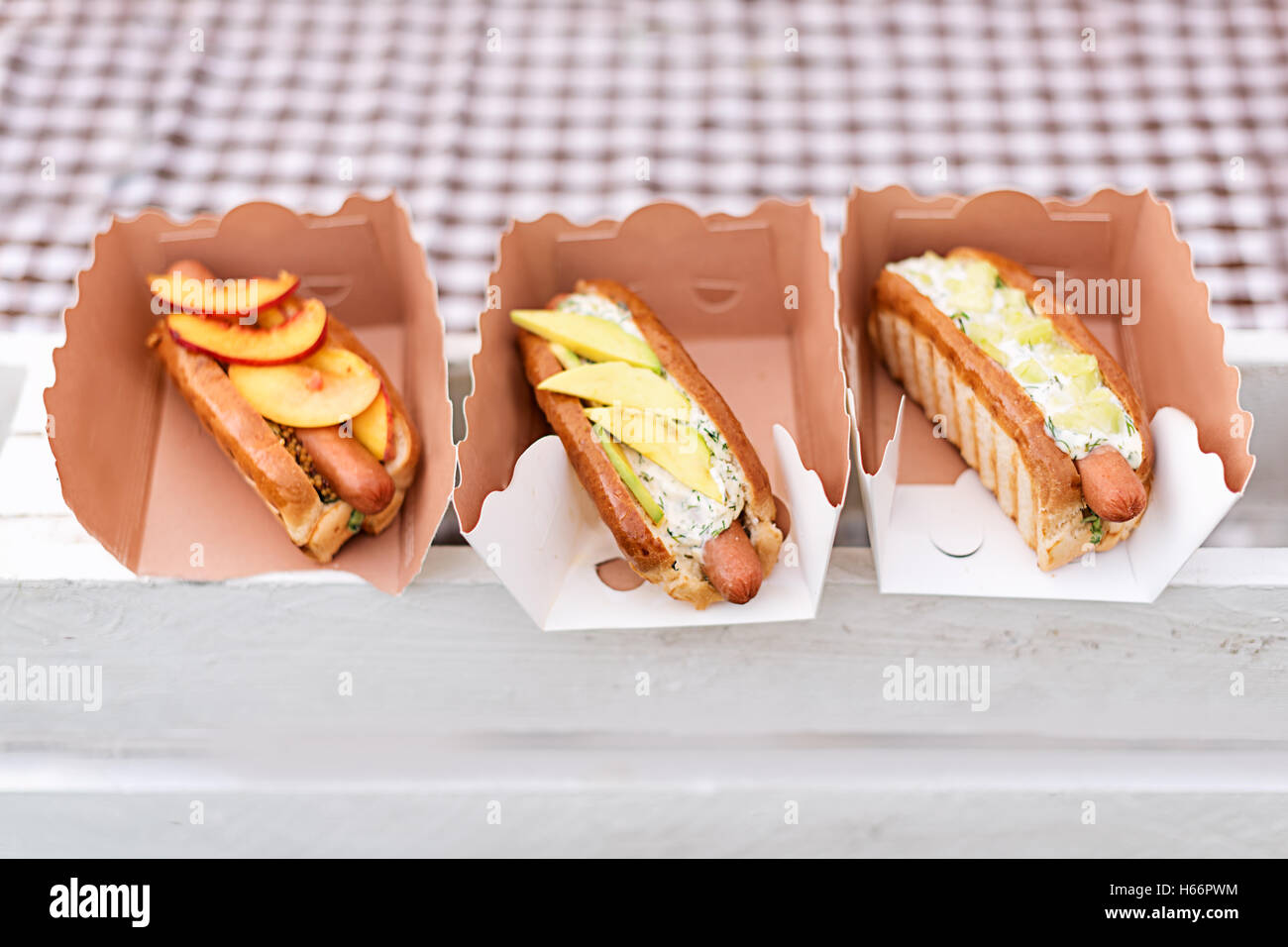 Street food. Special hot dogs with fruits. - Stock Image