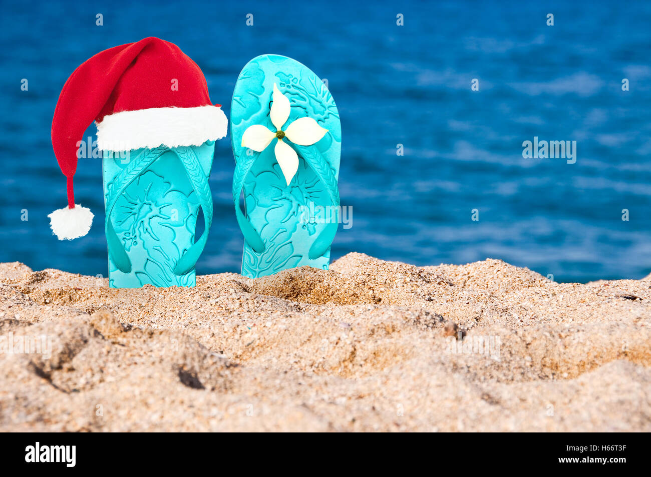 27bb186a Christmas hat on flip flops in the sand of a beach Stock Photo ...