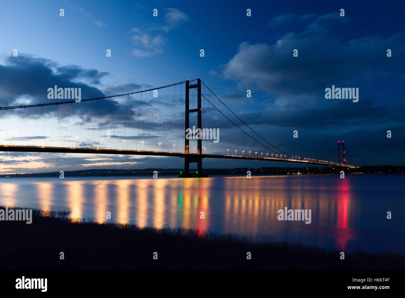 The Humber Bridge and the River Humber after dark. Barton-upon-Humber, North Lincolnshire, UK. 17th October 2016. - Stock Image