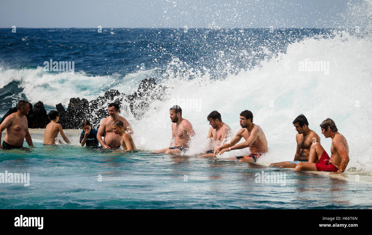 Tourists and local people enjoy a bath in the open air Atlantic Ocean sea water natural swimming pools of Porto - Stock Image