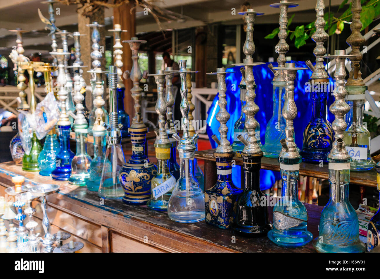 Shisha pipes on a shelf in the Hookah Lounge of a Turkish restaurant. - Stock Image