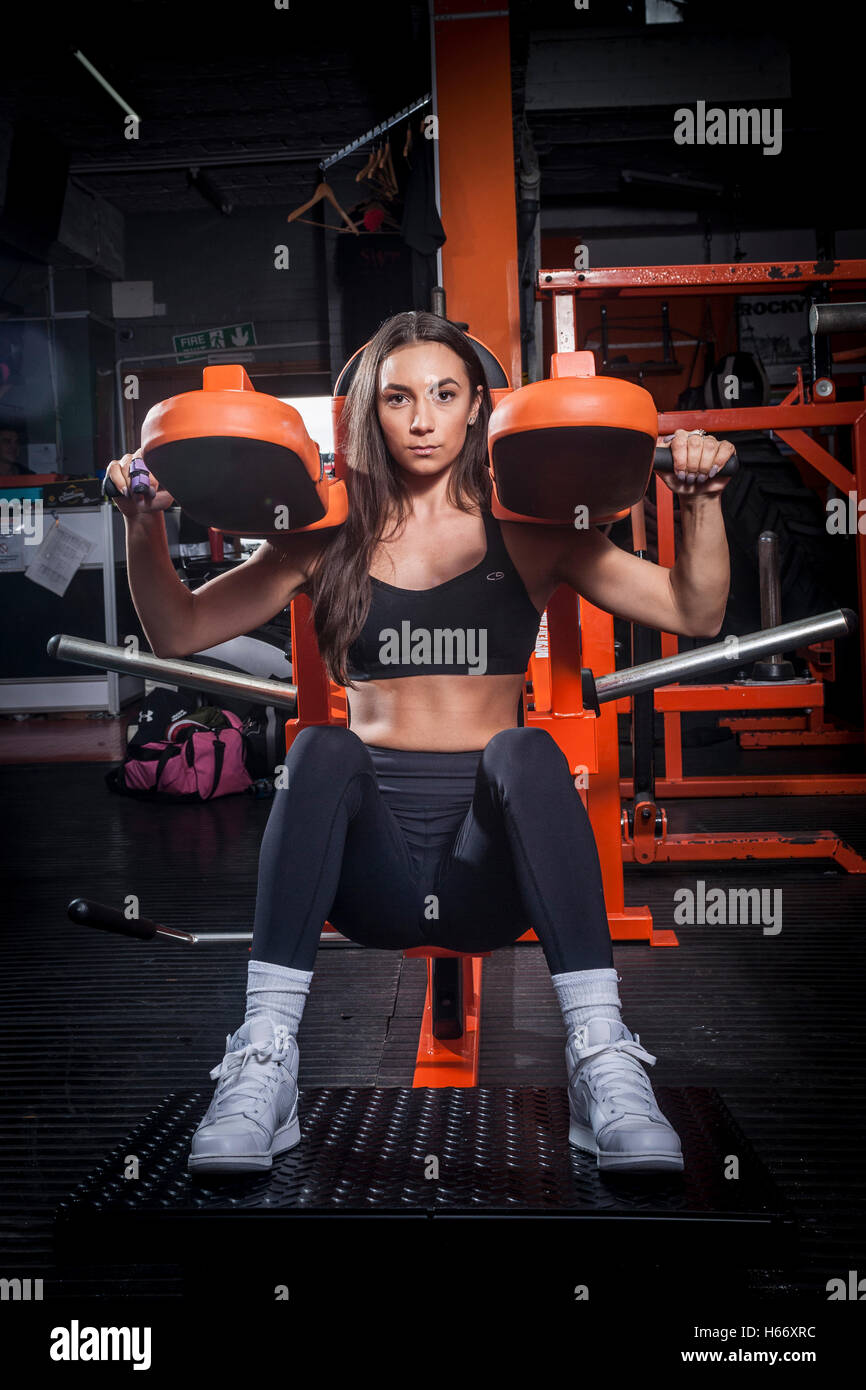 woman bodybuilder working out in the gym - Stock Image