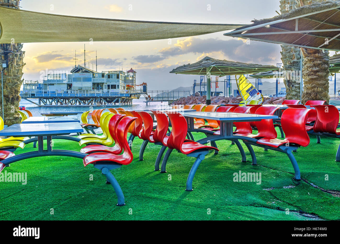 The scenic outdoor cafe, located in beach zone, next to the yacht club, Eilat Stock Photo