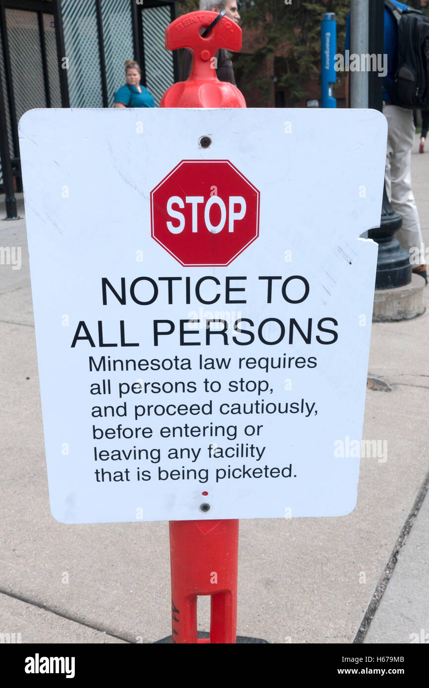 Picket sign outside Abbot NW Hospital asking people to stop and proceed slowly at this facility. Minneapolis Minnesota - Stock Image