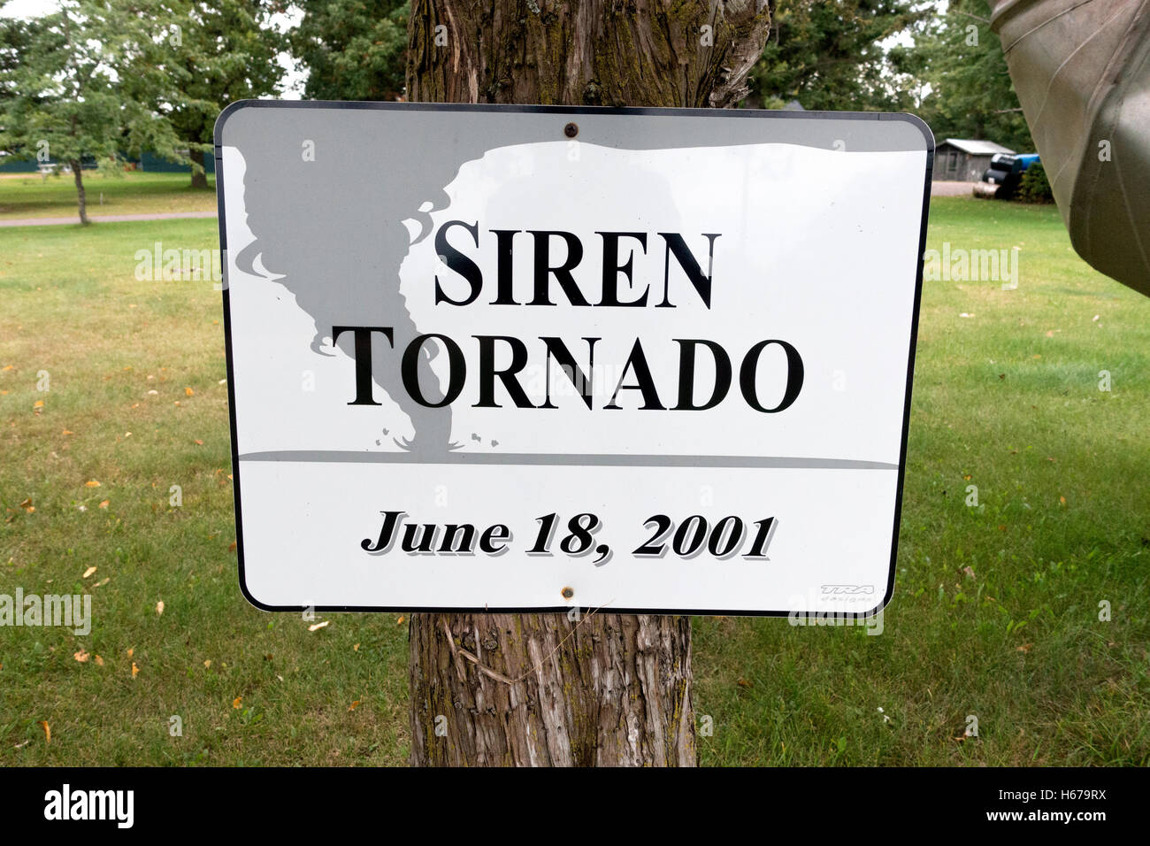 Exhibit sign memorializing the tornado of June 18, 2001 with a bent aluminum rowboat around a pole. Siren Wisconsin - Stock Image