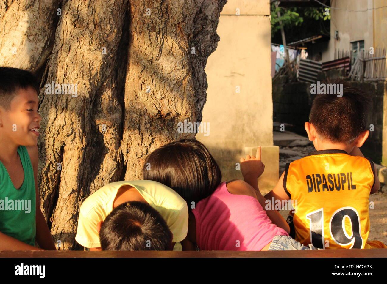 Shy kids in Mabini, Philippines - Stock Image