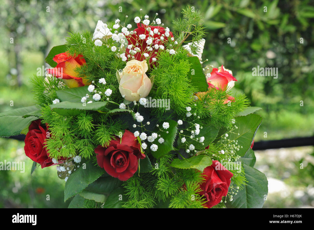 Wedding bouquet is important accessory of the event. Bride chooses it respect  the style and the color of the wedding - Stock Image